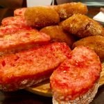 Croquetas and pan con tomate on a Barcelona tapas tour. Photo by Stacie White Brooks